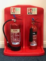 Fire extinguishers sited on a stand